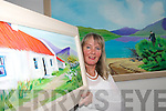 ART ATTACK: Dromid artist Brid O'Mahony with some her paintings  featured in an exhibition at Caherciveen Library which opened on Thursday last. .