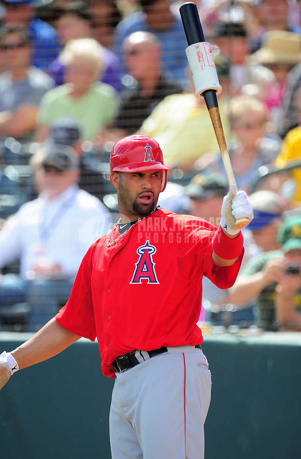 Mar. 4, 2012; Phoenix, AZ, USA; Los Angeles Angels first baseman Albert Pujols against the Oakland Athletics during a spring training game at Phoenix Municipal Stadium.  Mandatory Credit: Mark J. Rebilas-