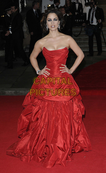 Berenice Marlohe.'Skyfall' Royal World Film Premiere, Royal Albert Hall, Kensington Gore, London, England..23rd October 2012.full length black strapless dress cleavage gathered hands on hips.CAP/CAN.©Can Nguyen/Capital Pictures.