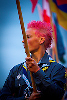 Swedish participand carrying flag in opening ceremony.