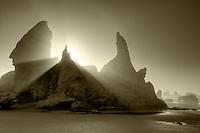 Sea stacks at Bandon Beach with fog and sun rays. Oregon