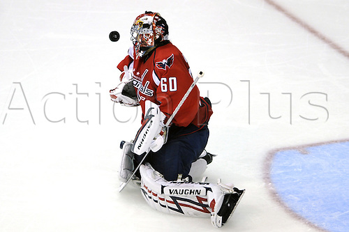 12th October 2009:  Washington Capitals goalie Jose Theodore (60) makes a save in the 3rd period in action against the New Jersey Devils at the Verizon Center in Washington, D.C.  The New Jersey Devils defeated the Washington Capitals 3-2 in a shootout. Photo by Mark Goldman/Actionplus. UK Licenses Only..