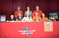 RICK PECK/SPECIAL TO MCDONALD COUNTY PRESS Callie Keaton (bottom row, center) recently signed to attend Oklahoma State University on a rodeo scholarship. Shown (front, left) is Rhett Keaton (brother), Jennifer Keaton (mom), Callie Keaton, Vance Keaton (dad) and Courtney Keaton (sister); (back) is MCHS FFA advisors Rob Hall, Emily Hutton and Shawn McAlister.