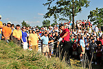 30 August 2009: Tiger Woods hits out of trouble on the 15th hole during the final round of The Barclays PGA Playoffs at Liberty National Golf Course in Jersey City, New Jersey.
