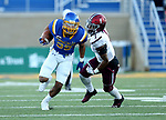 BROOKINGS, SD - OCTOBER 7: Isaac Wallace #35 from South Dakota State University tries to slip past Craig James #1 from Southern Illinois in the first half of their game Saturday night at Dana J. Dykhouse Stadium in Brookings. (Photo by Dave Eggen/Inertia)