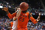 12 March 2015: Notre Dame's Pat Connaughton (behind) knocks the ball away from Miami's Tonye Jekiri (23). The Notre Dame Fighting Irish played the University of Miami Hurricanes in an NCAA Division I Men's basketball game at the Greensboro Coliseum in Greensboro, North Carolina in the ACC Men's Basketball Tournament quarterfinal game. Notre Dame won the game 70-63.