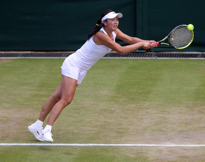 Shuai Peng (CHN) in action playing against Petra Kvitova (CZE) [6] in their Ladies' Singles Fourth Round match today<br /> <br /> Photographer Kieran Galvin/CameraSport<br /> <br /> Tennis - Wimbledon Lawn Tennis Championships - Day 7 Monday 30th June 2014 -  All England Lawn Tennis and Croquet Club - Wimbledon - London - England<br /> <br /> &copy; CameraSport - 43 Linden Ave. Countesthorpe. Leicester. England. LE8 5PG - Tel: +44 (0) 116 277 4147 - admin@camerasport.com - www.camerasport.com.