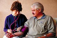 Nurse administering blood pressue test.