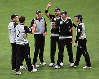 NZ players celebrate during 2nd Twenty20 cricket match match between New Zealand Black Caps and West Indies at Westpac Stadium, Wellington, New Zealand on Friday, 27 February 2009. Photo: Dave Lintott / lintottphoto.co.nz