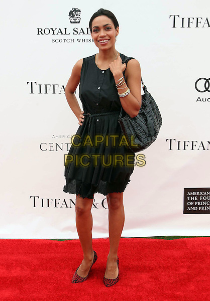 Rosario Dawson.Audi At The Foundation Polo Challenge held at the Santa Barbara Polo & Racquet Club, Santa Barbara, California, USA, 9th July 2011..full length sleeveless dress  black  red shoes buttons hand on hip .CAP/ADM/KB.©Kevan Brooks/AdMedia/Capital Pictures.