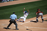 GLENDALE, AZ - MARCH 9:  Chone Figgins of the Los Angeles Dodgers slides home safely during a spring training game against the San Francisco Giants at Camelback Ranch in Glendale, Arizona on March 9, 2014. Photo by Brad Mangin
