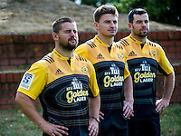From left, Dane Coles, Beauden Barrett and James Marshall with the new strip. Hurricanes rugby jersey promotion at Rugby League Park, Wellington, New Zealand on Thursday, 10 March 2016. Photo: Dave Lintott / lintottphoto.co.nz