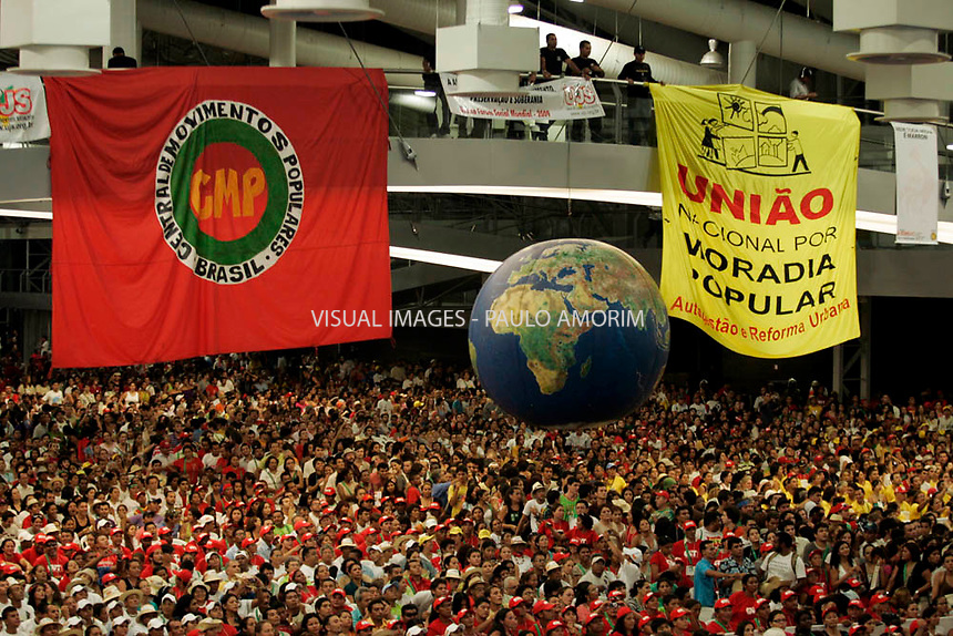 People attend the World Social Forum main ceremony, in Belem, Brazil, Thursday, Jan. 30, 2009. The World Social Forum, the annual countercultural gathering to protest the simultaneous World Economic Forum in Switzerland.