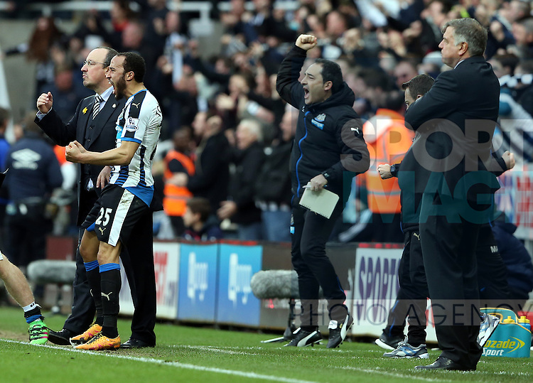 Newcastle United's manager Rafael Benitez, left, celebrates Aleksandar Mitrovic's goal during the Barclays Premier League match at St James' Park Stadium. Photo credit should read: Scott Heppell/Sportimage