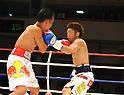 (L-R) Pornsawan Porpramook (THA), Akira Yaegashi (JPN), OCTOBER 24, 2011 - Boxing : Pornsawan Porpramook of Thailand hits Akira Yaegashi of Japan during the first round of the WBA minimumweight title bout at Korakuen Hall in Tokyo, Japan. (Photo by Mikio Nakai/AFLO)