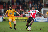 Piero Mingoia of Cambridge United and Liam Davis of Cheltenham Town during the Sky Bet League 2 match between Cheltenham Town and Cambridge United at the LCI Stadium, Cheltenham, England on 18 March 2017. Photo by Mark  Hawkins / PRiME Media Images.