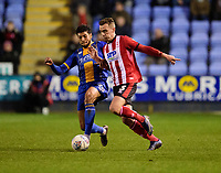 Lincoln City's Harry Toffolo battles with Shrewsbury Town's Josh Laurent<br /> <br /> Photographer Andrew Vaughan/CameraSport<br /> <br /> The EFL Sky Bet League One - Shrewsbury Town v Lincoln City - Saturday 11th January 2020 - New Meadow - Shrewsbury<br /> <br /> World Copyright © 2020 CameraSport. All rights reserved. 43 Linden Ave. Countesthorpe. Leicester. England. LE8 5PG - Tel: +44 (0) 116 277 4147 - admin@camerasport.com - www.camerasport.com