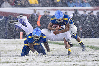 PHILADELPHIA, PA - DEC 9, 2017: Army Black Knights linebacker James Nachtigal (19) makes a great tackle jumping over a Navy blocker to tackle Navy Midshipmen Quarterback Malcolm Perry (10) for a loss during game between Army and Navy at Lincoln Financial Field Philadelphia, PA. Army defeated Navy 14-13 to win the Commander in Chief Cup. (Photo by Phil Peters/Media Images International)