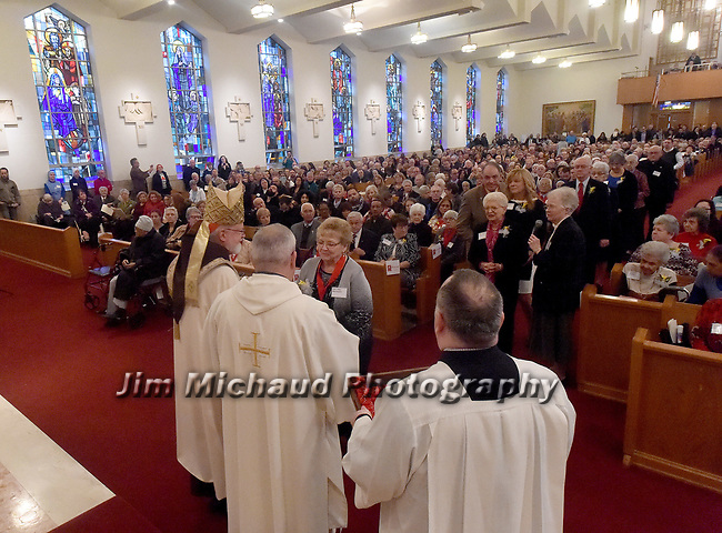 MALDEN MA NOVEMBER25: Cardinal Sean O'Malley gives the award to Alice Harrington of of Saint Theresa of Lisieux Parish in Bellerica, during the 2018 Cheverus awards, Harrington was one of the 125 recipients, Sunday, November 25, 2018, at the Immaculate Conception Church in Malden. (Herald Photo by Jim Michaud)
