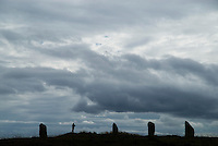 Silhouette of stones and woman standing at Ring of Brodgar, Orkney