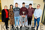 Paul O'Shea captain of the Kerry U20's with the Munster U20 Cup on his visit to the Kerry Colleges Clash campus on Monday. <br /> L to r: Carmel Kelly, Mary Lucey (Principal),  Deividas Uosis, Paul O'Shea, Darragh Rahilly and Kevin Beasley