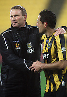 Phoenix coach Ricki Herbert congratulates decisive goalscorer Leo Bertos after the match during the A-League football match between Wellington Phoenix and Perth Glory at Westpac Stadium, Wellington, New Zealand on Sunday, 16 August 2009. Photo: Dave Lintott / lintottphoto.co.nz