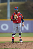 NJIT Highlanders relief pitcher Aquib Ramkishun (10) looks to his catcher for the sign against the High Point Panthers at Williard Stadium on February 18, 2017 in High Point, North Carolina. The Panthers defeated the Highlanders 11-0 in game one of a double-header. (Brian Westerholt/Four Seam Images)