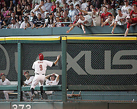 Astros OF Hunter Pence watches Phillies Ryan Howard HR leave the field on Saturday May 24th at Minute Maid Park in Houston, Texas. Photo by Andrew Woolley / Four Seam Images.