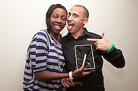 Comedienne Gina Yashere is presented with a gold plated microphone by Riki Capone, who runs 'Goldie Horns' plating in Long Eaton. The presentation took place during her set at the newly opened Glee Club, the former Jongleurs, in the city.