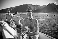 DAMIEN HOBGOOD (USA), BEN DUNN (AUS),  and DAVEY WEARE (ZAF) share a boat at Teahupoo, Tahiti, Thursday May 7 2009. Photo: joliphotos.com