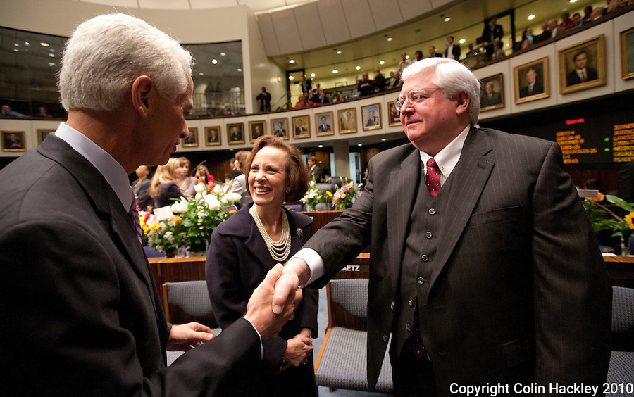 TALLAHASSEE, FLA. 3/2/10-OPENING DAY CH-Gov. Charlie Crist, left, talks with Florida Supreme Court Justice Barbara Pariente and Florida Supreme Court Justice R. Fred Lewis during the opening day of the legislative session, Tuesday at the Capitol in Tallahassee...COLIN HACKLEY PHOTO