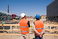 "milano, periferia nord. cantiere per la realizzazione di un parcheggio nell'ambito del progetto di riqualificazione dell'ex area carlo erba di piazzale maciachini - via imbonati --- milan, north periphery. construction site for a parking within the requalification project of the former ""carlo erba"" area in maciachini square -  imbonati street."