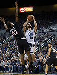 Nevada forward Caleb Martin (10) shoots over San Diego State guard Jeremy Hemsley (42) in the second half of an NCAA college basketball game in Reno, Nev., Saturday, Mar. 9, 2019. (AP Photo/Tom R. Smedes)