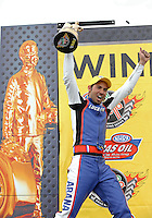 Mar. 17, 2013; Gainesville, FL, USA; NHRA pro stock motorcycle rider Hector Arana Jr celebrates after winning the Gatornationals at Auto-Plus Raceway at Gainesville. Mandatory Credit: Mark J. Rebilas-