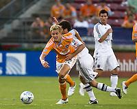 D.C. United midfielder Ben Olsen (14) attempts to hold off the advance of Houston Dynamo midfielder Stuart Holden (22).  Houston Dynamo defeated D.C. United 4-3 at Robertson Stadium in Houston, TX on August 1, 2009.