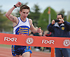 Nick Morfesi, 19, of West Babylon wins the Long Island Marathon Weekend's 5K race by crossing the finish line at Mitchel Athletic Complex on Saturday, Apr. 30, 2016.