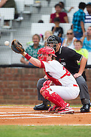 Johnson City Cardinals catcher Charlie Neil (32) catches a high pitch as home plate umpire Brock Ballou looks over his shoulder during the game against the Elizabethton Twins at Cardinal Park on July 27, 2014 in Johnson City, Tennessee.  The game was suspended in the top of the 5th inning with the Twins leading the Cardinals 7-6.  (Brian Westerholt/Four Seam Images)