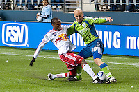 Freddie Ljungberg (r) and Dane Richards (l) battle as the Seattle Sounders lost to the New York Red Bulls, 1-0, in an MLS match on Saturday, April 3, 2010 at Qwest Field in Seattle, WA.