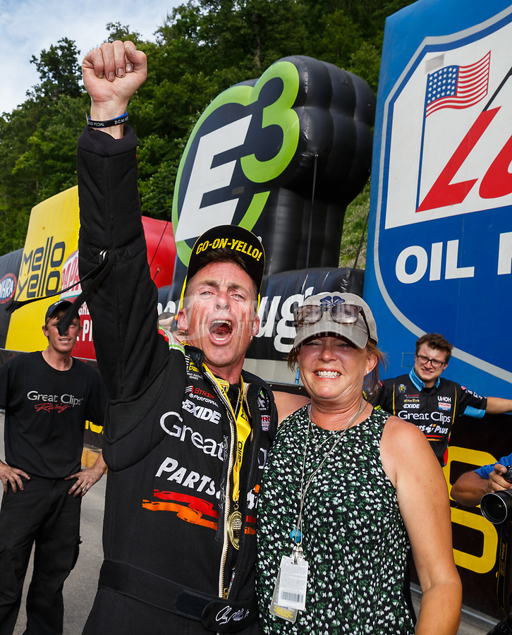 Jun 18, 2017; Bristol, TN, USA; NHRA top fuel driver Clay Millican celebrates with wife Donna Millican after winning the Thunder Valley Nationals at Bristol Dragway. Mandatory Credit: Mark J. Rebilas-USA TODAY Sports