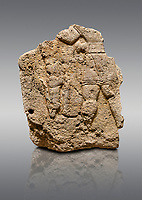 Picture &amp; image of Hittite relief sculpted orthostat stone panel of Long Wall Limestone, Karkamıs, (Kargamıs), Carchemish (Karkemish), 900 - 700 B.C. Anatolian Civilizations Museum, Ankara, Turkey. The short-skirted figure with a dagger at the waist holds the gazelle from its hind legs<br /> <br /> On a gray background.