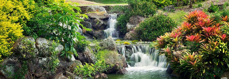 Waterfall in garden at Four Seasons hotel. Lanai, Hawaii.