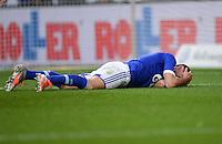 FUSSBALL   1. BUNDESLIGA   SAISON 2012/2013    29. SPIELTAG FC Schalke 04 - Bayer 04 Leverkusen                        13.04.2013 Ciprian Marica (FC Schalke 04) liegt bereits bei der Spielentwicklung zum 0:1 verletzt auf dem Boden
