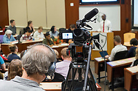 """A video camera records as New York Assemblyman (79th District) and Vice Chair of the Democratic National Committee Michael Blake speaks to a live audience during a session of Resistance School in the Starr Auditorium in the Belfer Building of Harvard University's John F. Kennedy School of Government, on Thurs., April 27, 2017. Blake's lecture was titled """"How to sustain the resistance long term."""" The lecture, which was the fourth such session and the final in what the group calls the """"first semester"""" of Resistance School, was also streamed live on the internet. Resistance School was started by progressive graduate students at Harvard after the Nov. 8, 2016, election of President Donald Trump. Resistance School describes itself as a """"practical training program that will sharpen the tools [needed] to fight back at the federal, state, and local levels."""" The live lectures are streamed and archived online alongside other information on the Resistance School website. During the lectures, teams of volunteers engage with followers on social media, including Facebook and twitter, sharing soundbytes, quotations, and supplementary materials as the lectures happen."""