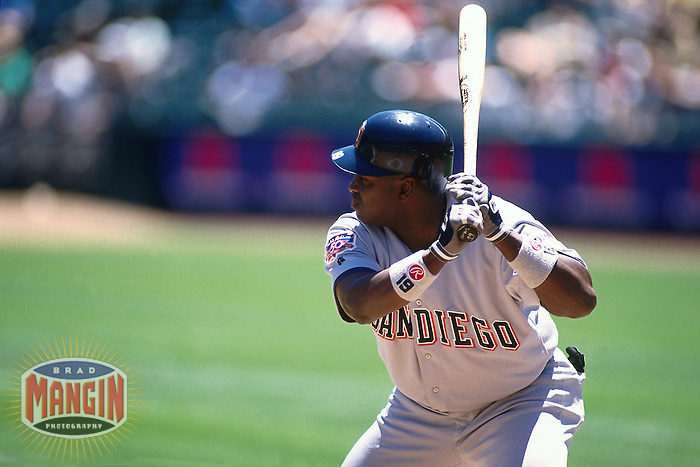 OAKLAND, CA - Tony Gwynn of the San Diego Padres bats during a game against the Oakland Athletics at the Oakland Coliseum in Oakland, California in 1997. Photo by Brad Mangin