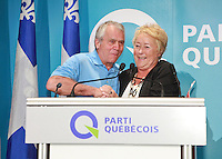 """PQ MNA Francois Gendron and Quebec Premier Pauline Marois shake hands at the """"Universite d'ete des jeunes du Parti Quebecois"""" event in Quebec City, Sunday August 25, 2013."""