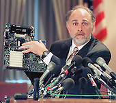 Washington, DC - June 8, 1998 -- William J. Baer, Director of the FTC's Bureau of Competition holds a computer board containing a Pentium chip to illustrate the case against Intel brought by the FTC today.<br /> Credit: Ron Sachs / CNP