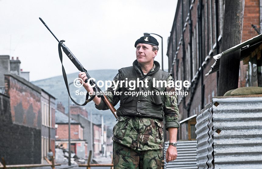 Soldier with rifle on duty outside observation post, Crumlin Road, Belfast, N Ireland, September, 1971, 197109000431m <br />