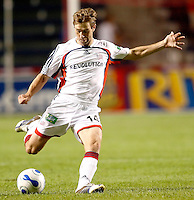 New England Revolution midfielder Steve Ralston (14) prepares to take a shot.  The Chicago Fire defeated the New England Revolution 2-1 in the quarterfinals of the U.S. Open Cup at Toyota Park in Bridgeview, IL on August 23, 2006...