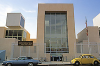 Frank Gehry: Frances Howard Goldwyn Hollywood Regional Library, 1986. Ivar Ave. Facade with 15 foot high security fence.