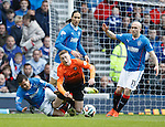 Arnold Peralta tackles Ryan Gauld in the box